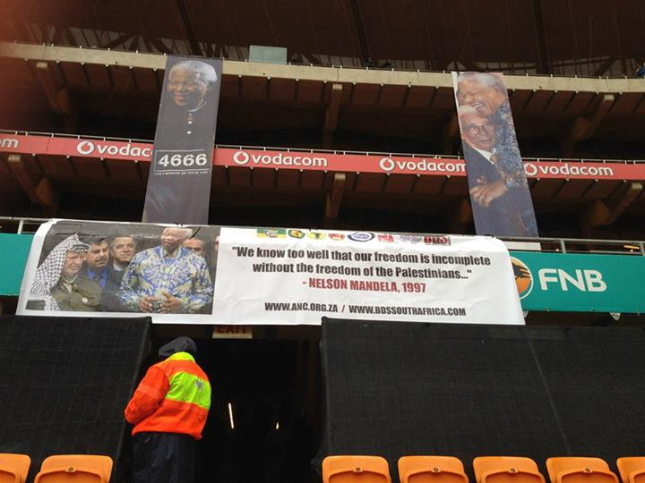 BDS MEDIA RELEASE: Huge Palestine Banners spotted at today's Mandela Memorial Event in Soweto